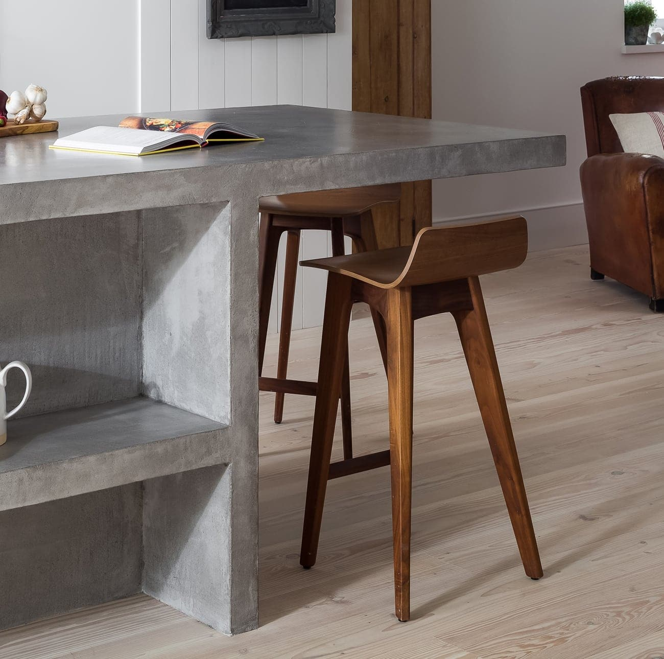 Light wood chairs under cement table