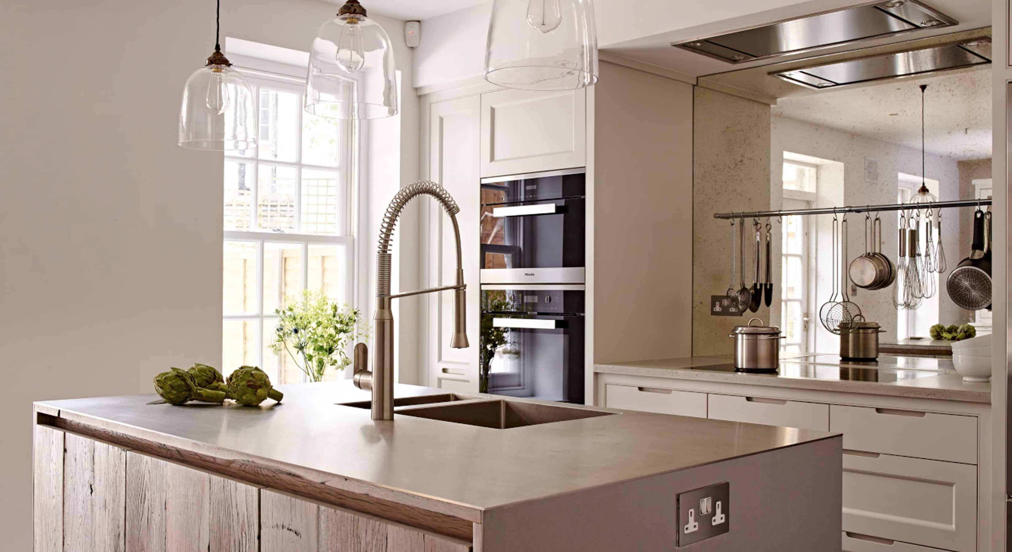 Modern kitchen concept with mirrored splashback