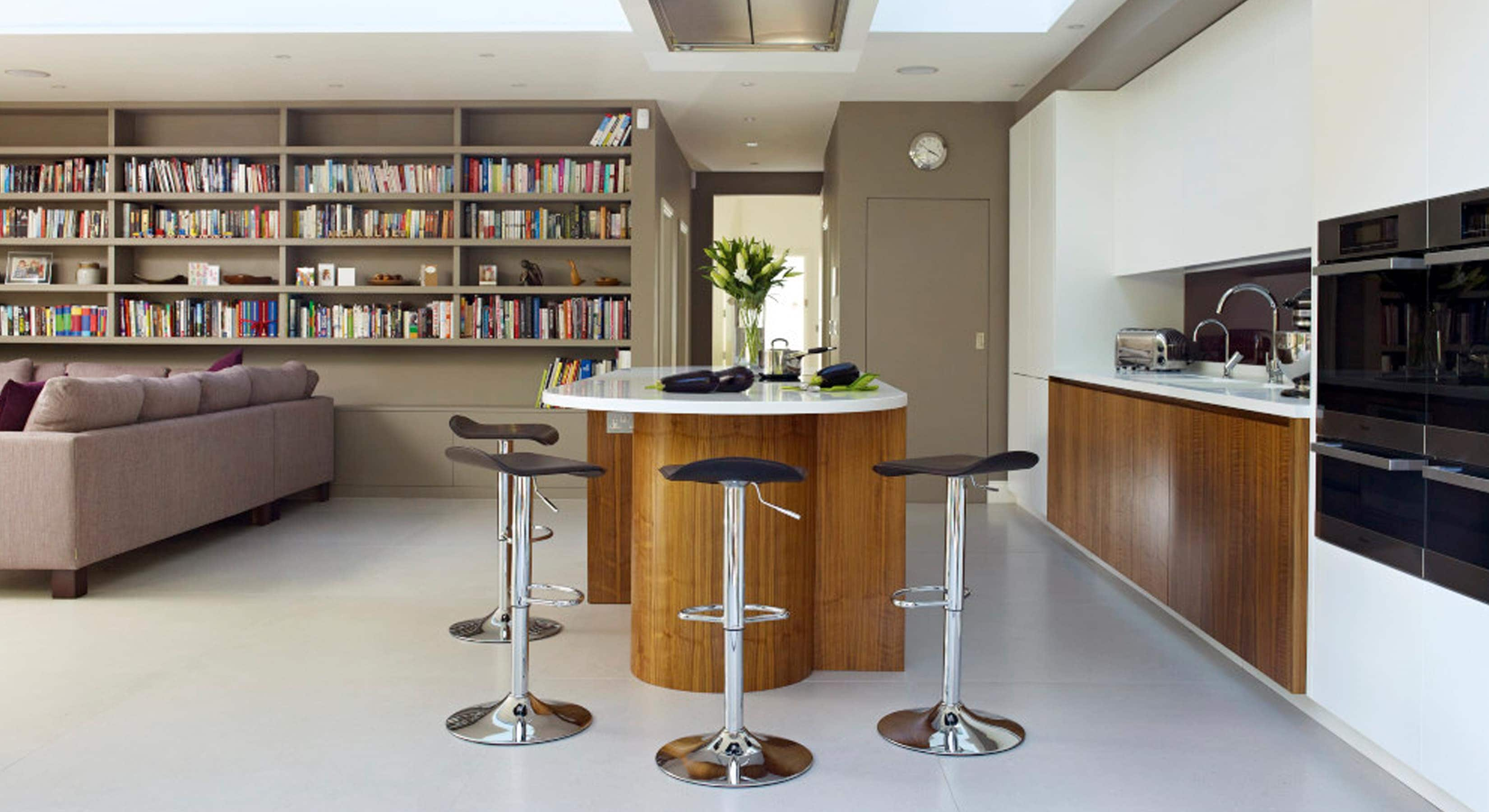 White and wood kitchen concept with rounded island