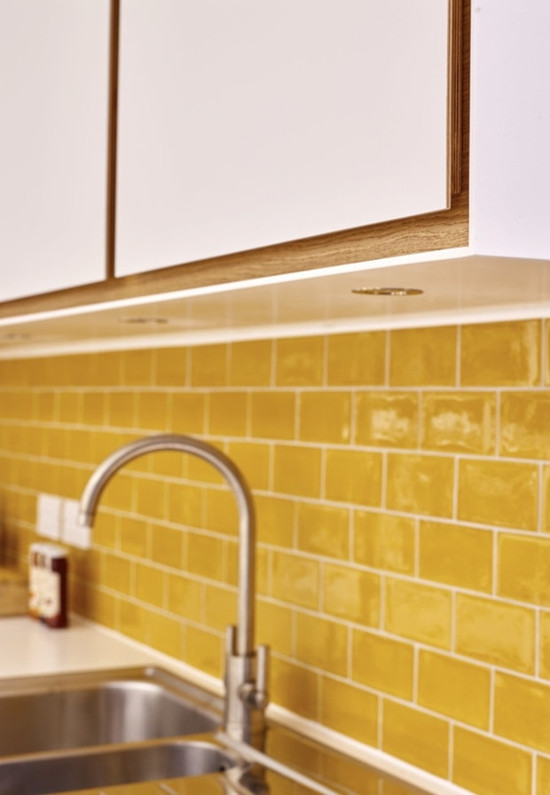 Striking yellow wall tiles and modern sink from the Moulds kitchen extension concept