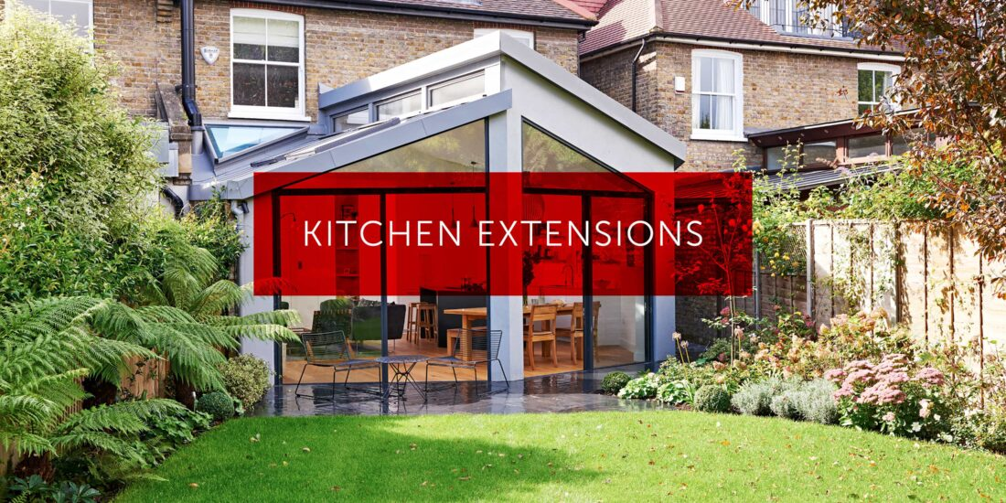 A kitchen extension with pitched rooves, white rendered walls and wood effect flooring.