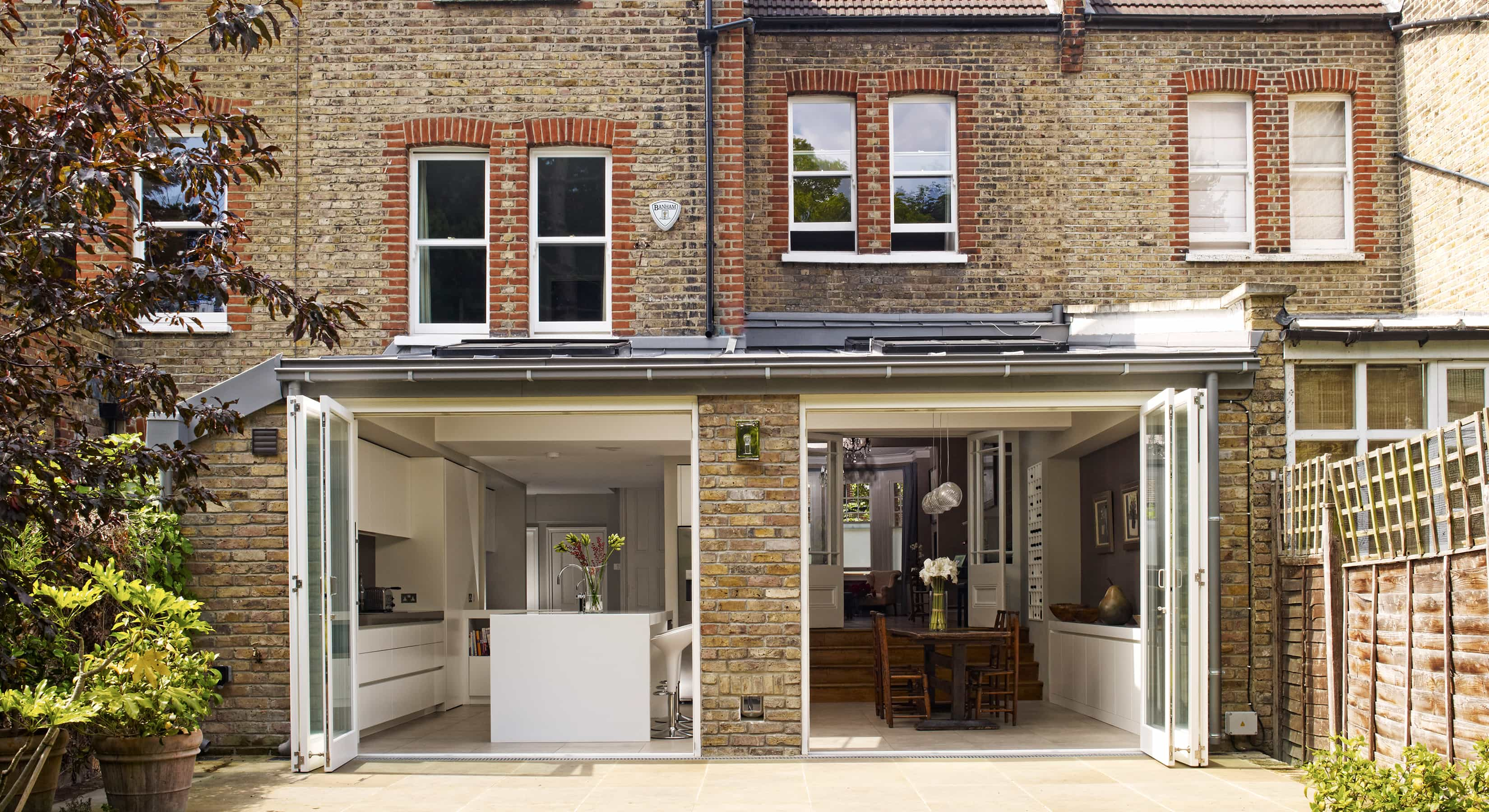 Exterior of the Esmund kitchen extension with by-fold doors open
