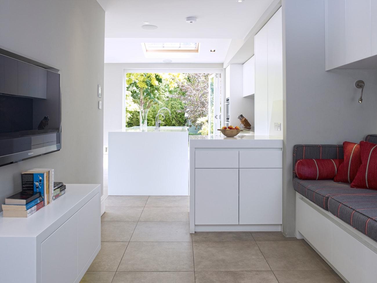 Esmund small lounge concept leading into kitchen