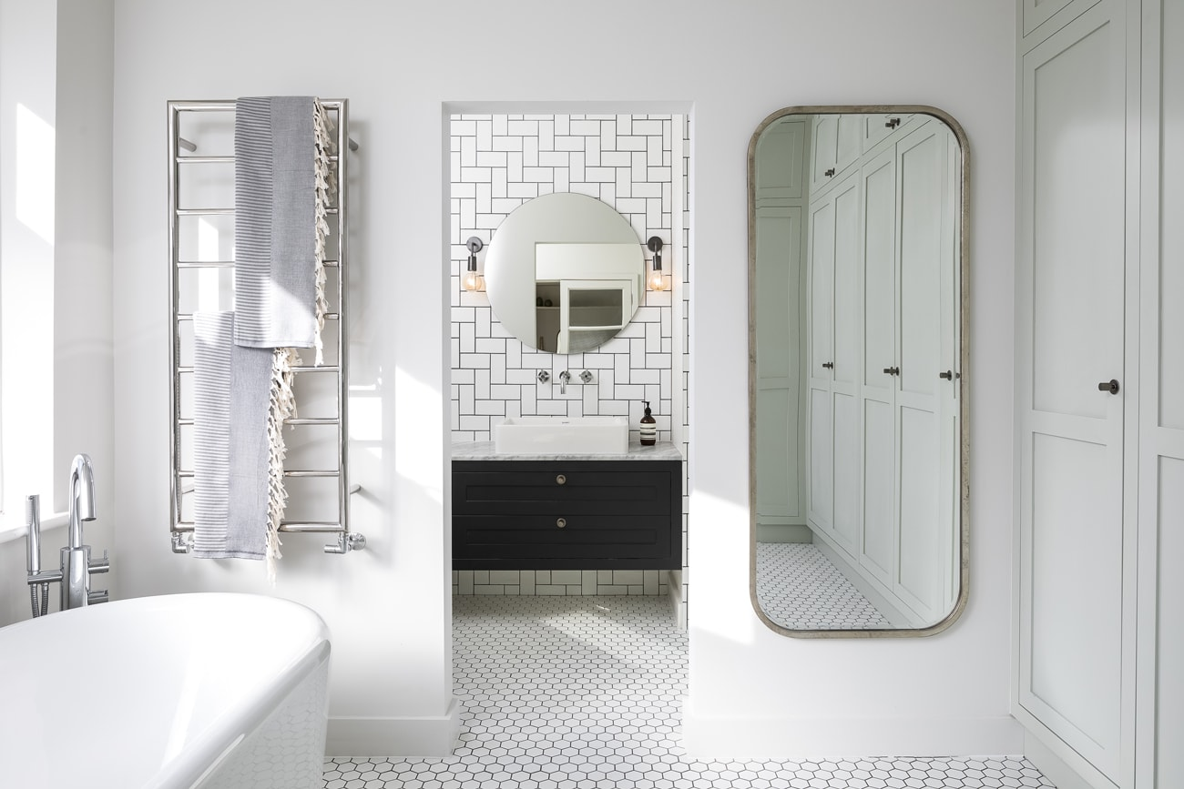 View to floating sin, mirror and towel radiator of the Lowther bathroom