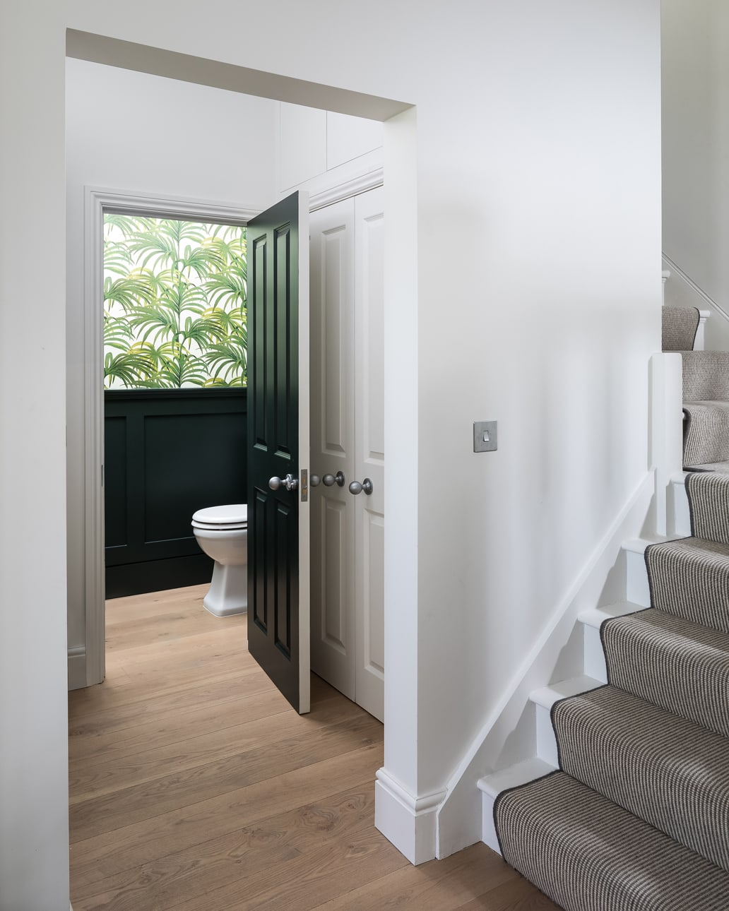 View into Lowther green bathroom and stairs