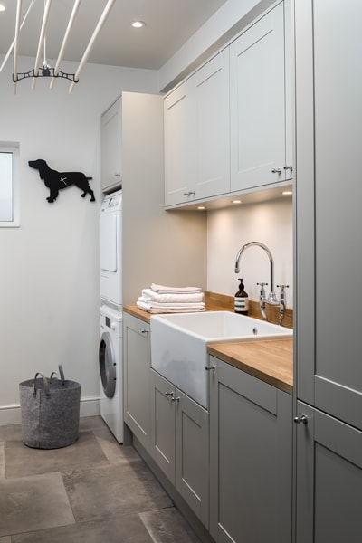 Lowther utility room concept with stacked appliances and Belfast sink