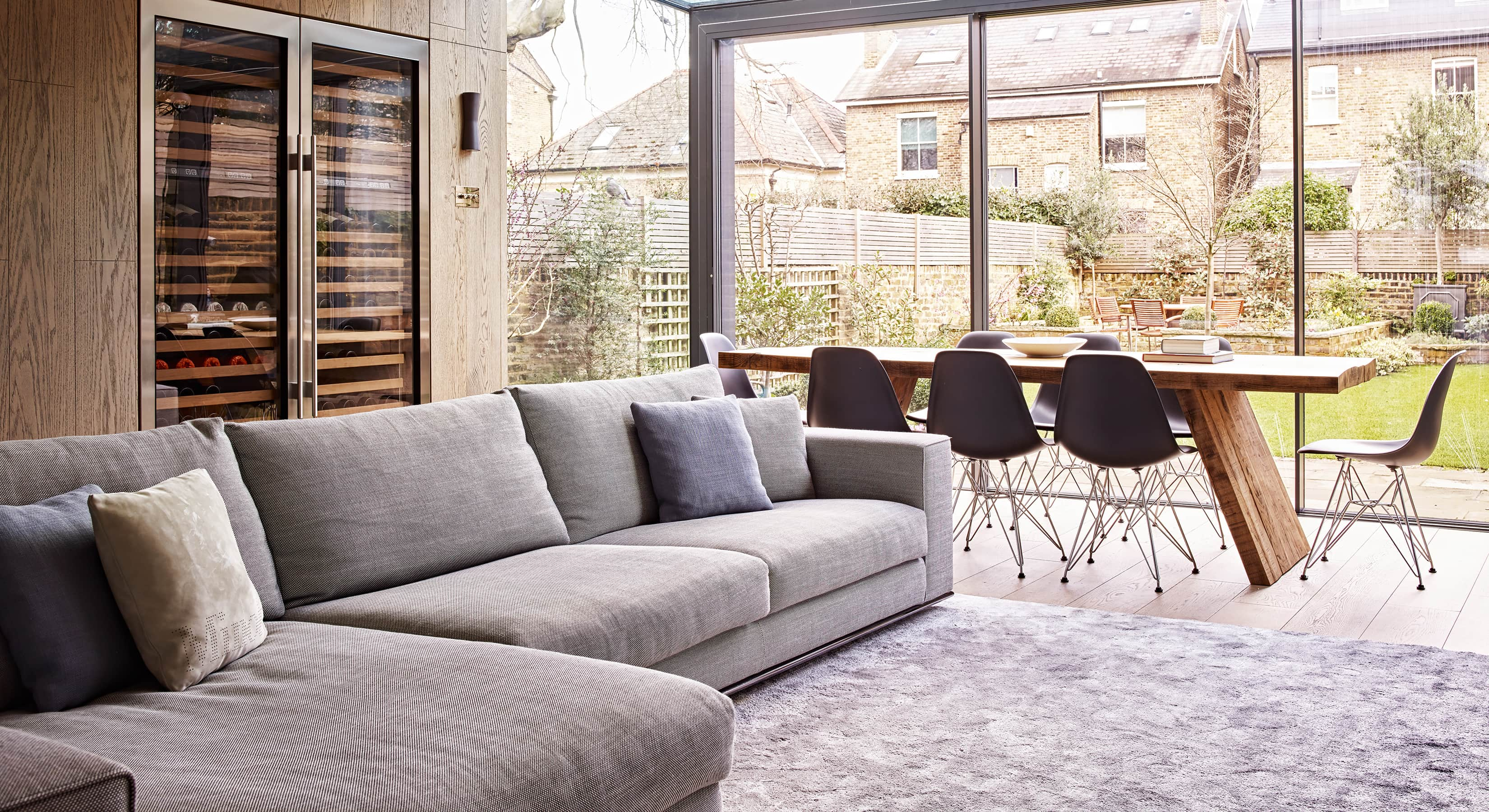 Living and dining areas of the Montegu kitchen extension with wine fridge