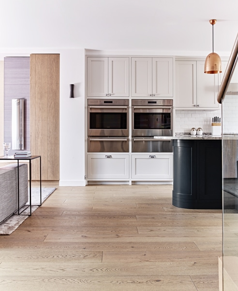Classic styled Montegu kitchen extension with two raised ovens and proving drawers with black island
