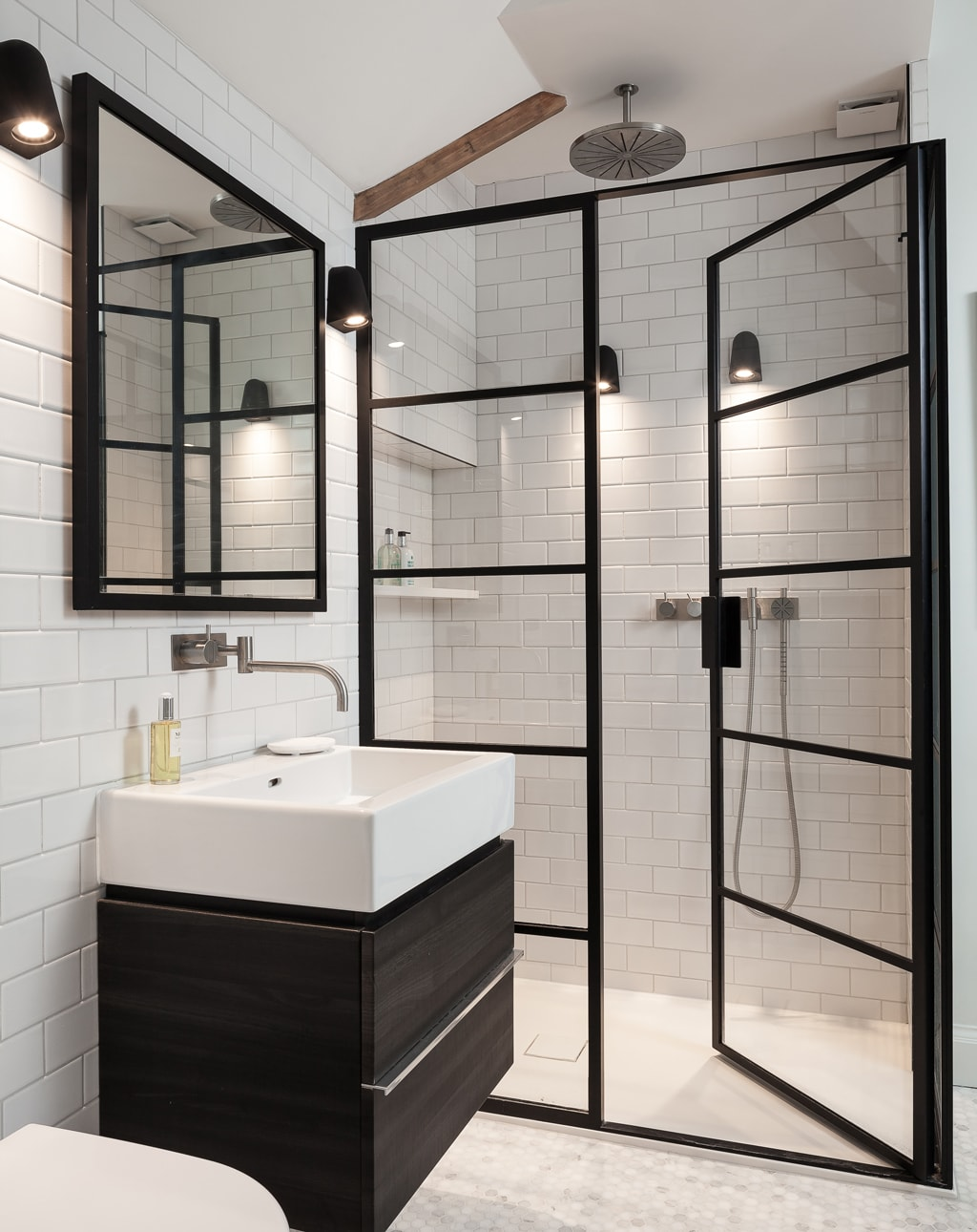 Industrial style bathroom with metal framed glass doors to the shower
