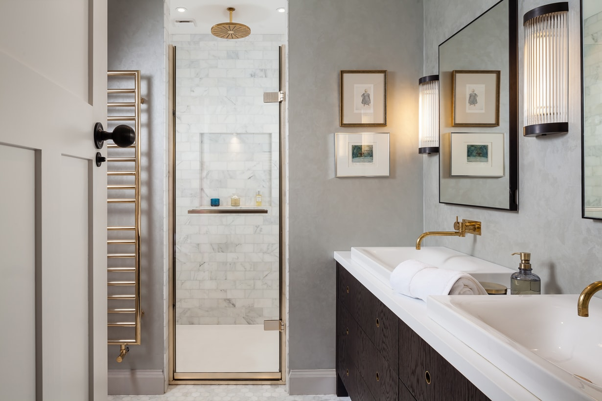 Bathroom concept with brass coloured fittings, plumbing and accessories.