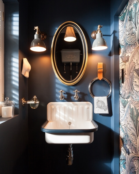 Industrial sink basen set on dark blue wall, with industrial style fittings and accessories