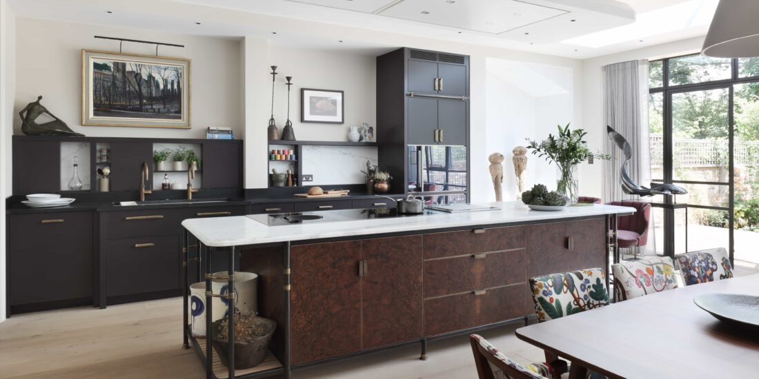 An industrial, art deco inspired kitchen with a central island for the hob and cabinets.